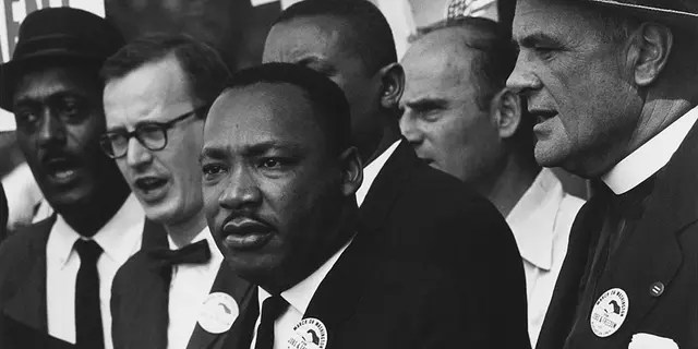Civil Rights March in Washington, DC, Drs.  In a crowd with Martin Luther King Jr. and Matthew Ahman.  (Nar - 582015 - Restoration. 2oration August 1963)