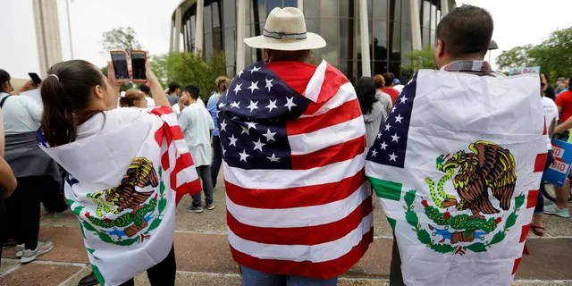 """FILE - In this June 26, 2017, file photo, protesters outside the federal courthouse in San Antonio, Texas, take part in a rally to oppose a new Texas """"sanctuary cities"""" bill that aligns with the president's tougher stance on illegal immigration. A federal appeals court gave Texas more latitude Monday, Sept. 25, 2017, to enforce a """"sanctuary cities"""" ban backed by the Trump administration, but opponents suing over the immigration crackdown said it was unlikely to drastically change the status quo. (AP Photo/Eric Gay, File)"""