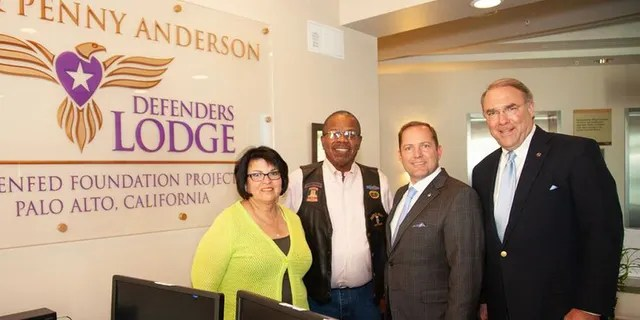 Elena and Billy Bryels (Veteran); James Schenck, President and CEO of PenFed Credit Union and Mark D. Smith, Director of Programs, PenFed Foundation tour the Lee & Penny Anderson Defenders Lodge.