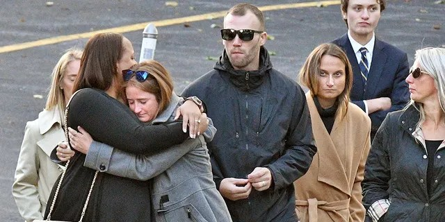"Mourners leave St. Stanislaus Roman Catholic Church during calling hours for Schoharie limo crash victims; Abigail (King) Jackson, Adam ""Action"" Jackson, Mary (King) Dyson, Robert J. Dyson, Allison A. King, Amy (King) Steenburg, Axel J. Steenburg and Richard Steenburg Jr., on Friday Oct. 12, 2018, in Amsterdam, N.Y. (John Carl D'Annibale/The Albany Times Union via AP)"