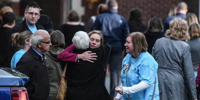 AMSTERDAM, NY: Mourners grieve after leaving a service at St. Stanislaus Roman Catholic Church for some of the victims in last weekend's fatal limo crash on October 12, 2018 in Amsterdam, New York. (Photo by Stephanie Keith/Getty Images)