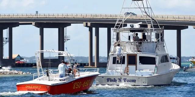 OCT. 8: Commercial boats leave the Destin Harbor in Destin, Fla.