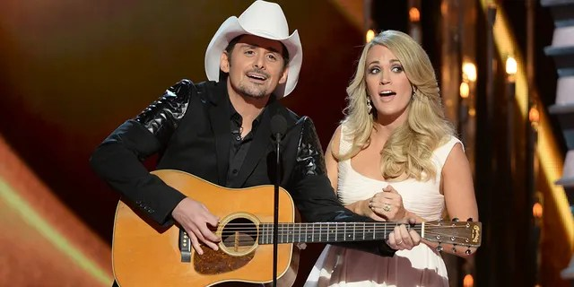 Brad Paisley and Carrie Underwood at the 2014 CMAs.