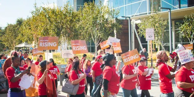 Activists from Silicon Valley Rising march on Google's campus in Mountain View, California, October 4, 2018.