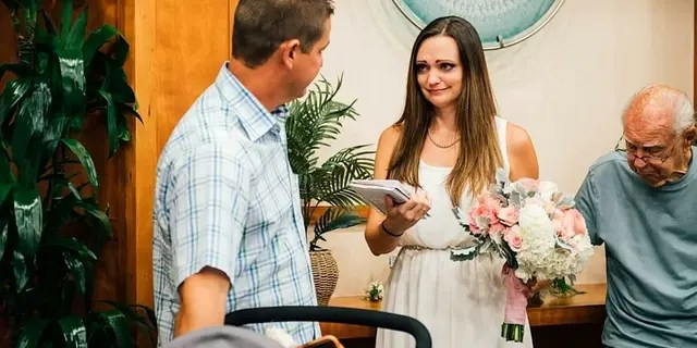 The couple's 60 guests were in attendance to watch them exchange vows alongside their son.