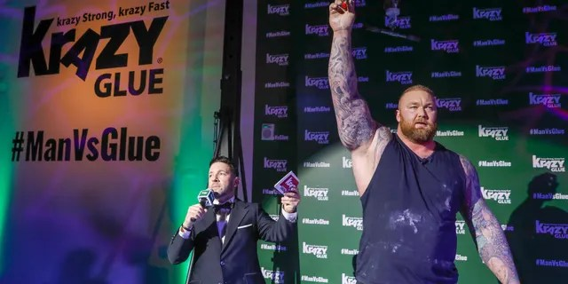 IMAGE DISTRIBUTED FOR KRAZY GLUE - Just one drop of Krazy Glue is strong enough to lift world's strongest man Hafthor Bjornsson and was put to the test at the Man Vs. Glue event.