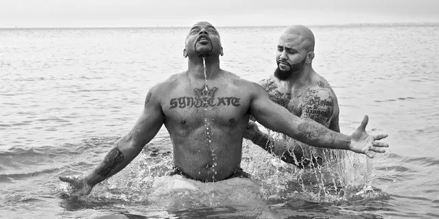 """Rene """"Level"""" Martinez baptizing his friend, Corey, who used to be in the gang Latin Syndicate with him."""