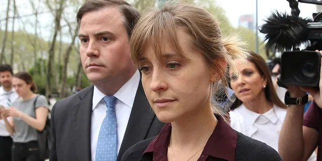 Actress Allison Mack (right) leaves U.S. Eastern District Court after a bail hearing in connection with the sex trafficking charges filed against her on May 4, 2018, in the Brooklyn neighborhood of New York City. The actress known for her role in