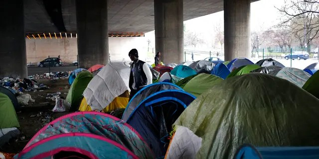 Migrants, mainly from Afghanistan, are occupying 200 tents under a highway in the north of the capital