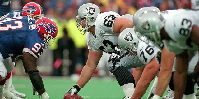 17 Oct 1999: Barrett Robbins #63 of the Oakland Raiders hikes the ball during the game against the Buffalo Bills at the Ralph Wilson Stadium in Orchard Park, New York. The Raiders defeated the Bills 20-14.