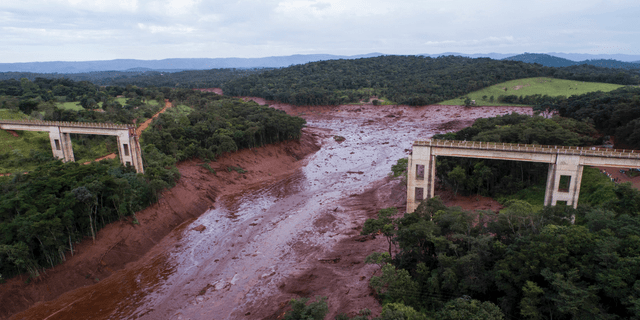 An aerial view shows a collapsed bridge caused by flooding triggered by a dam collapse near Brumadinho, Brazil, Friday, Jan. 25, 2019.