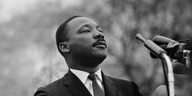 Dr. Martin Luther King, Jr. speaking before a crowd of 25,000 civil rights marchers in front of the state capital building on March 25, 1965, in Montgomery, Ala. (Stephen F. Somerstein/Getty Images)
