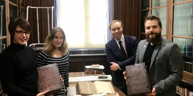 Left to right: Leah Tether, Laura Chuhan Campbell, Michael Richardson and Benjamin Pohl with the books in Bristol Central Library's Rare Books Room