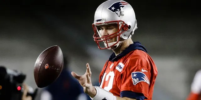 New England Patriots quarterback Tom Brady catches a ball during NFL football practice, Wednesday, Jan. 30, 2019, in Atlanta, as the team prepares for Super Bowl 53 against the Los Angeles Rams.
