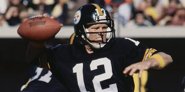 Pittsburgh Steelers' quarterback Terry Bradshaw prepares to throw a pass to one of his fellow teammates.
