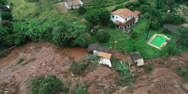 An aerial view shows a partially destroyed house after a dam collapsed, in Brumadinho, Brazil, Saturday, Jan. 26, 2019.