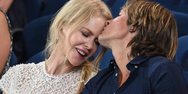 Nicole Kidman and Keith Urban share an affectionate moment at the Rod Laver Arena as they attend the 2019 Australian Open at Melbourne Park on January 24, 2019 in Melbourne, Australia.