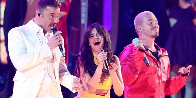"""Ricky Martin, from left, Camila Cabello and J Balvin perform """"Havana"""" at the 61st annual Grammy Awards on Sunday, Feb. 10, 2019, in Los Angeles."""