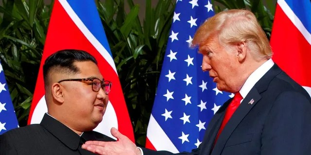 Kim Jong Un and President Trump are seen during their summit in Singapore in June 2018. (Associated Press)