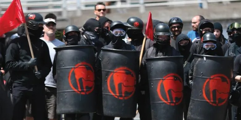 Antifa protesters at a rally. (Mark Graves/The Oregonian/via AP)