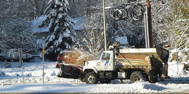 A City of Olympia sanding truck makes it way up a street on Sunday, Feb. 10, 2019, in Olympia, Wash.