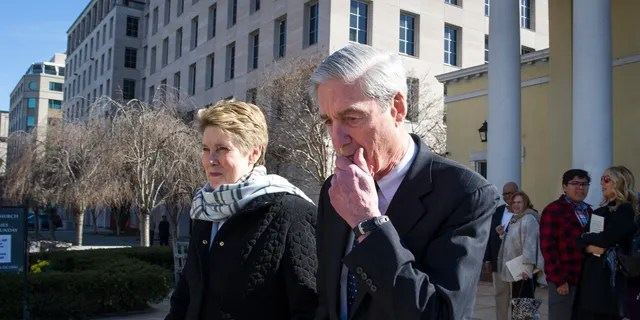Special Counsel Robert Mueller, and his wife,Ann, leaving St. John's Episcopal Church, across from the White House, in Washington on Sunday. (AP Photo/Cliff Owen)