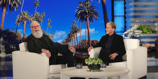 In this March 7, 2019 photo released by Warner Bros., David Letterman appears with host Ellen DeGeneres during a taping of