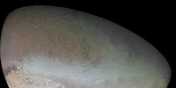 Triton's global color mosaic, taken in 1989 by Voyager 2 during its flyby of the Neptune system.  (Credit: NASA / JPL / USGS)