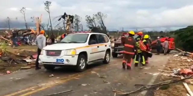 Emergency responders work in the scene amid debris in Lee County, Ala., after a tornado struck in the area Sunday, March 3, 2019.