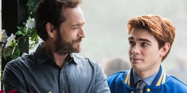 """Luke Perry, left, pictured here as Fred Andrews, with his on-screen son, Archie Andrews, right, portrayed by KJ Apa on The CW's """"Riverdale."""""""