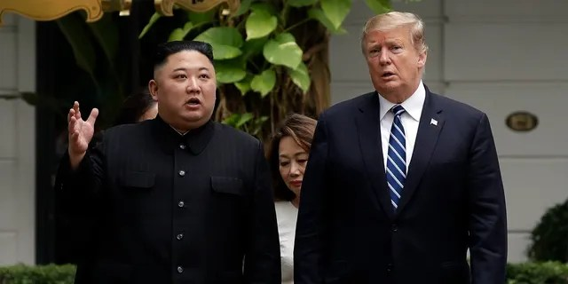 President Donald Trump and North Korean leader Kim Jong Un take a walk after their first meeting at the Sofitel Legend Metropole Hanoi hotel, in Hanoi. Kim says he's open to having a third summit with Trump if the United States could offer mutually-acceptable terms for an agreement by the end of the year. (AP Photo/Evan Vucci, File)