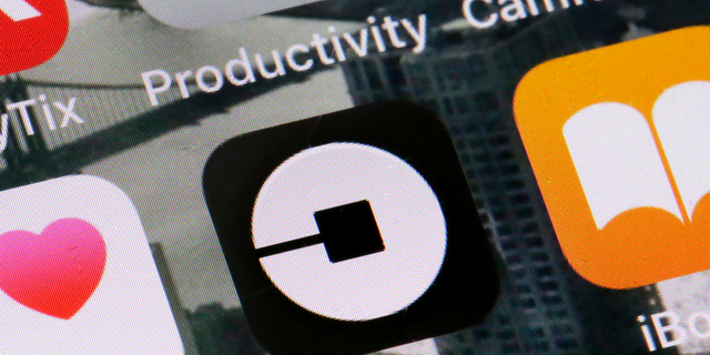 The icon for the Uber app is seen on a phone in New York, June 12, 2018. (Associated Press)