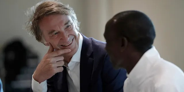 Marathon world record holder Kenya's Eliud Kipchoge and Britain's richest person Jim Ratcliffe, the founder of the INEOS Chemicals company. (AP Photo/Matt Dunham)