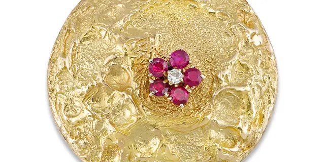 The brooch is shaped to resemble the lunar surface.