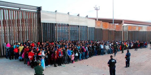 Some of the 1,036 migrants who crossed the U.S.-Mexico border in El Paso, Texas, the largest that the Border Patrol says it has ever encountered. (U.S. Customs and Border Protection via AP)