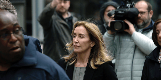"""""""Her efforts weren't driven by need or desperation, but by a sense of entitlement, or at least moral cluelessness, facilitated by wealth and insularity,"""" the U.S. Attorney wrote in a filing. (AP Photo/Steven Senne)"""