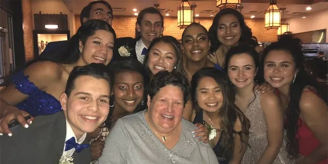 An older woman paid for the dinner of a group of kids from Clarksburg High School on prom night. (Therese de Leonn)