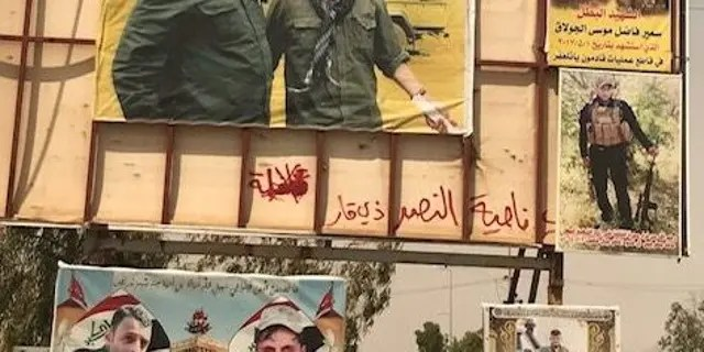 A poster of Qassem Soleimani adorns the entrance of the Iraqi city of Tel Afar in the months after it was liberated from ISIS.