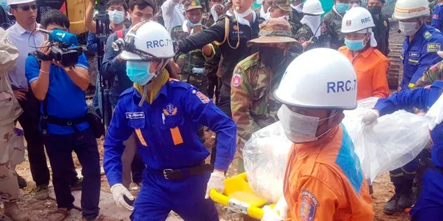 In this photo provided by Preah Sihanouk Provincial Authority, rescuers carry the body of a victim at the site of a building collapse on Monday in Preah Sihanouk province, Cambodia.