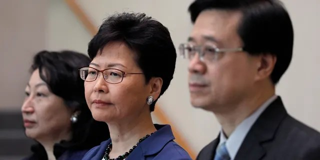 Hong Kong Secretary for Security John Lee, right, Hong Kong Chief Executive Carrie Lam, center, and Secretary of Justice Teresa Cheng listen to reporters questions during a press conference in Hong Kong Monday, June 10, 2019.