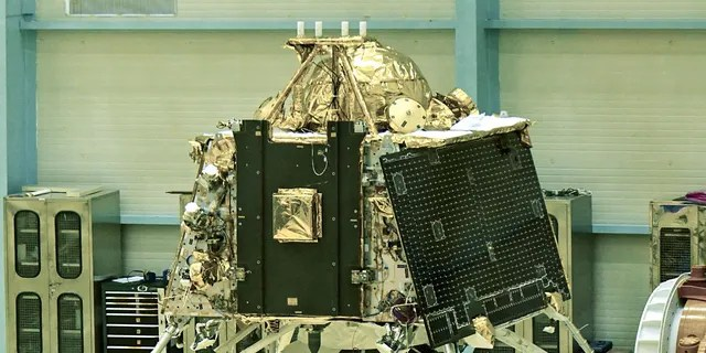 Indian Space Research Organization (ISRO) scientists work on the orbiter vehicle of Chandrayaan-2, India's first Moon lander and rover mission, in Bangalore.