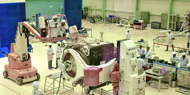 Scientists work on the Chandrayaan-2 orbiter vehicle in Bangalore on June 12, 2019.
