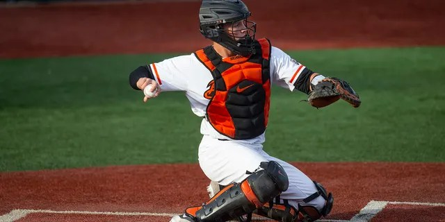 FILE - In this April 26, 2019, file photo, Adley Rutschman catches for Oregon State during an NCAA college baseball game against Washington State in Corvallis, Ore. (AP Photo/Chris Pietsch, File)