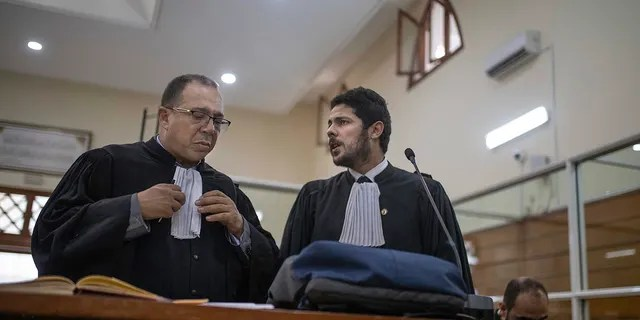 Lawyers gather inside a courtroom before the start of a final trial session for suspects charged in connection with the killing of two Scandinavian tourists in Morocco, in Sale, near Rabat, Morocco, Thursday, July 18, 2019.