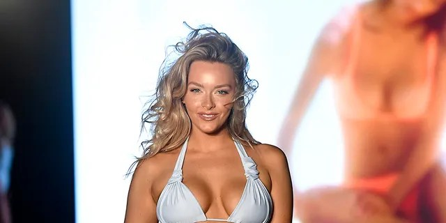 Camille Kostek walks the runway during the 2019 Sports Illustrated Swimsuit Runway Show During Miami Swim Week At W South Beach - Runway at WET poolside lounge at W South Beach on July 14, 2019 in Miami Beach, Florida.