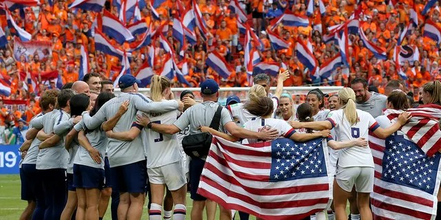 Members of the US team celebrate at the end of the Women's World Cup final soccer match between US and The Netherlands at the Stade de Lyon in Decines, outside Lyon, France, Sunday, July 7, 2019. US won 2:0. (AP Photo/David Vincent)