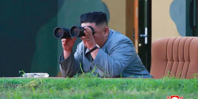 In this July 25 North Korean government photo, Kim Jong Un watching a missile test in North Korea. (Korean Central News Agency/Korea News Service via AP)