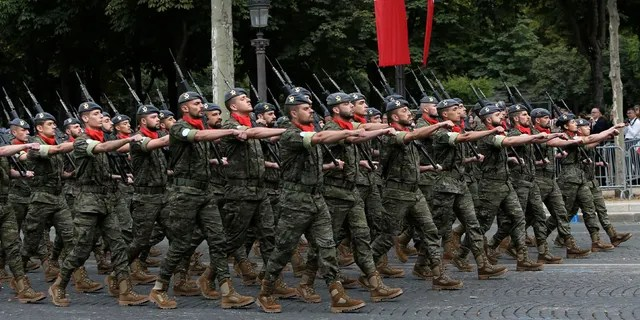 Portuguese troops take part to Bastille Day parade Sunday, July 14, 2019, on the Champs-Elysees avenue in Paris.