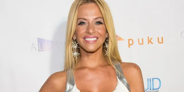"""In this July 21, 2014, file photo, Dina Manzo attends 'The Real Housewives of New Jersey' White Party at the Woodbury Country Club on Monday, in New York. Earlier this month, Thomas Manzo was indicted after being accused of being an alleged """"accomplice"""" in an incident three years ago that left Dina and her then-fiancéDavid Cantin beaten, tied up and robbed, according to a report.(Photo by Scott Roth/Invision/AP, File)"""