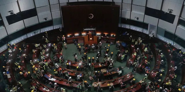 Protesters gather inside the meeting hall of the Legislative Council in Hong Kong, Monday, July 1, 2019.